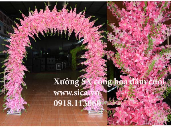 Cổng cưới hoa lan chuỗi hạt màu hồng phấn